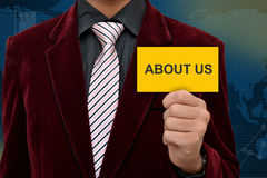 Professional holding about us card with business royalty free stock photos