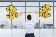 A professional holds a sketched dollar weight in the panoramic office with New York view. Royalty Free Stock Photo