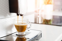 Professional home coffee maker machine making espresso Stock Photography