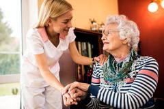 Nurse visit her senior patient at home. Professional home treatment, nurse visit her senior patient at home Stock Image