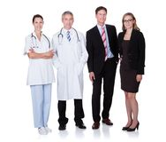 Professional hospital staff. Hospital staff represented by both the medical profession in the form of a doctor and the business administrators Stock Photos