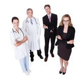 Professional hospital staff. Hospital staff represented by both the medical profession in the form of a doctor and the business administrators Royalty Free Stock Photo