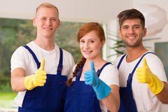 Professional house cleaners smiling. Holding thumbs up royalty free stock photos