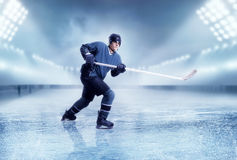 Professional ice hockey player shooting. Stadium on background. Ice-skating Royalty Free Stock Photography