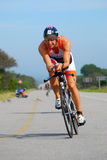 Professional Ironman triathlete cycling Stock Image
