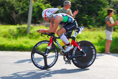 Professional Ironman triathlete cycling royalty free stock image