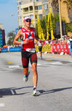 Professional Ironman triathlete running Royalty Free Stock Photos