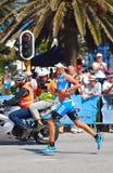 Professional Ironman triathlete running royalty free stock photos