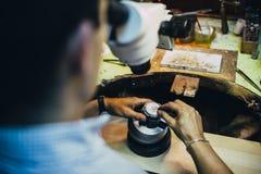 Professional jeweler working royalty free stock photos
