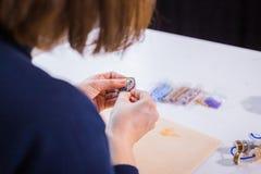 Designer making handmade brooch Royalty Free Stock Images