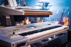 Professional keyboards on guitars and light sunset. In studio Royalty Free Stock Photo