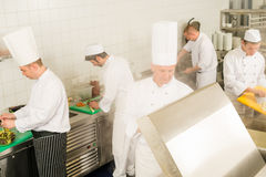 Professional kitchen busy team cooks and chef Stock Image