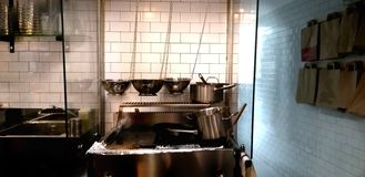 Professional kitchen of a fast-food restaurant with pans and pots stock photos