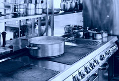 Professional kitchen interior, toned. Professional kitchen interior, crock on stove, blue tone Royalty Free Stock Photos