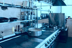 Professional kitchen interior, toned. Professional kitchen interior, crock on stove, blue tone Royalty Free Stock Image
