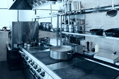 Professional kitchen interior, toned. Professional kitchen interior, crock on stove, toned image Stock Photography