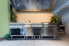 Professional kitchen in modern building Royalty Free Stock Photos