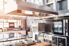 Professional kitchen of restaurant. Modern equipment and devices. Empty kitchen in the morning. Professional kitchen interior of restaurant. Modern equipment royalty free stock images