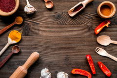 Professional kitchen with spices for cook on wooden background top view mockup. Professional kitchen with pepper and spices for cook concept on wooden desk royalty free stock photos