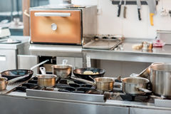 Professional kitchen stove. Professional equipped stove at the restaurant kitchen stock images