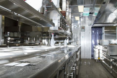 Professional kitchen , view counter in steel . Bokeh . Stock Photos