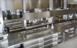 Professional kitchen , view counter in steel . Bokeh . Royalty Free Stock Photography