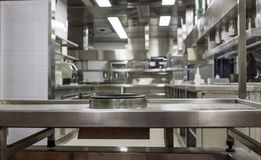 Professional kitchen , view counter in steel . Bokeh . Royalty Free Stock Photos