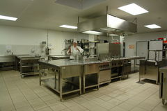 Professional Kitchen With Chef Cook Stock Photos