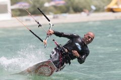 Professional  Kitesurfer jumps over the water during training on Royalty Free Stock Image