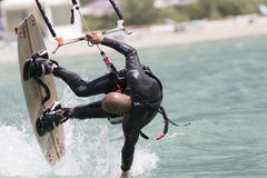 Professional  Kitesurfer jumps over the water during training on Stock Photography