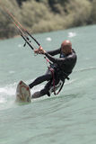 Professional  Kitesurfer jumps over the water during training on Royalty Free Stock Images