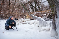 Professional on the lake. Nature photographer takes photos Royalty Free Stock Images