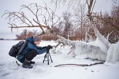 Professional on the lake. Nature photographer Stock Photo