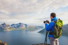 Professional landscape and nature photographer with tripod outdoors. Travel to Norway Stock Photos