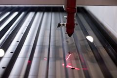 Professional laser cutting machine. laser light of a cnc plotter stock image