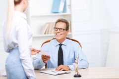 Professional lawyer giving papers to his assistant Stock Image