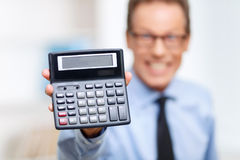 Professional lawyer holding calculator Stock Photography