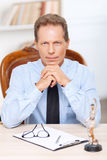 Professional lawyer sitting at the table Royalty Free Stock Image