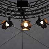 Professional lighting equipment near ceiling of theater stage. Royalty Free Stock Photo