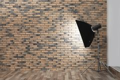 Professional lighting equipment near wall in photo studio royalty free stock images