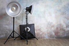 Professional lighting equipment in the photo studio on the original gray background. Minimalist interior and lighting equipment stock image