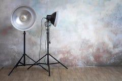 Professional lighting equipment in the photo studio on the original gray background. Minimalist interior and lighting equipment stock photography