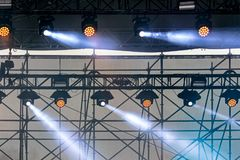 Professional lightning equipment on outdoor concert stage . Professional lightning equipment, spotlights on outdoor concert stage stock images