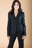 Professional look. Young woman poses wearing a blue pants suit Royalty Free Stock Photo
