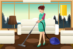 Professional maid vacuuming carpet. A vector illustration of professional maid vacuuming carpet in the living room Stock Photos