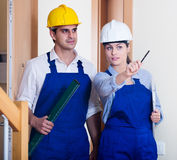 Professional maintenance crew of two specialists indoors Stock Photos