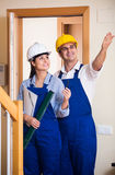 Professional maintenance crew of two specialists indoors Stock Photography
