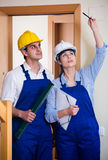 Professional maintenance crew of two specialists indoors Royalty Free Stock Photos