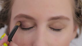 Professional make-up artist applying eyeshadow stock footage