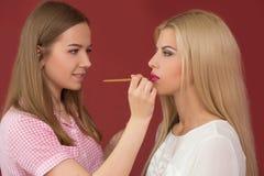 Professional Make-up artist doing glamour model Stock Photos